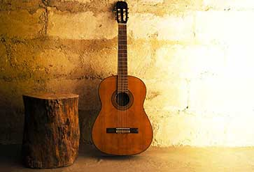 Acoustic Guitar on Old Wall