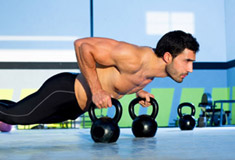 Man Push-up with Kettlebell