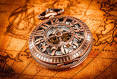 Pocket Watch On An Ancient World Map