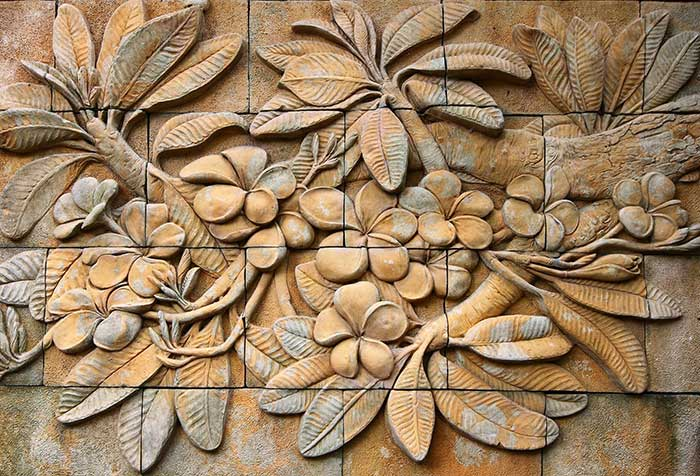 Thai style handcraft of plumeria wallpaper in stone